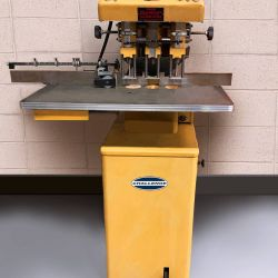 Drill press for a variety of custom holes at Printing Unlimited print shop