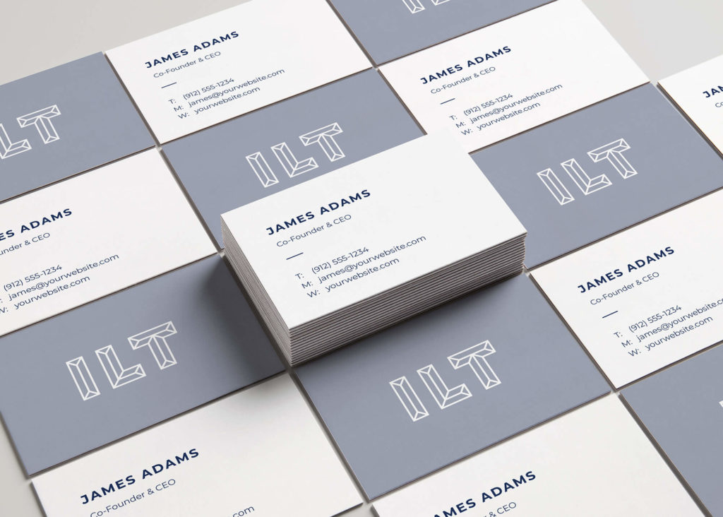 Blue and white business cards are organized across the picture.