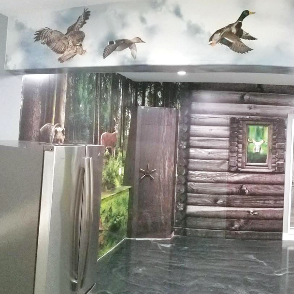 wide format printing example of garage with a forest cabin scene on the walls