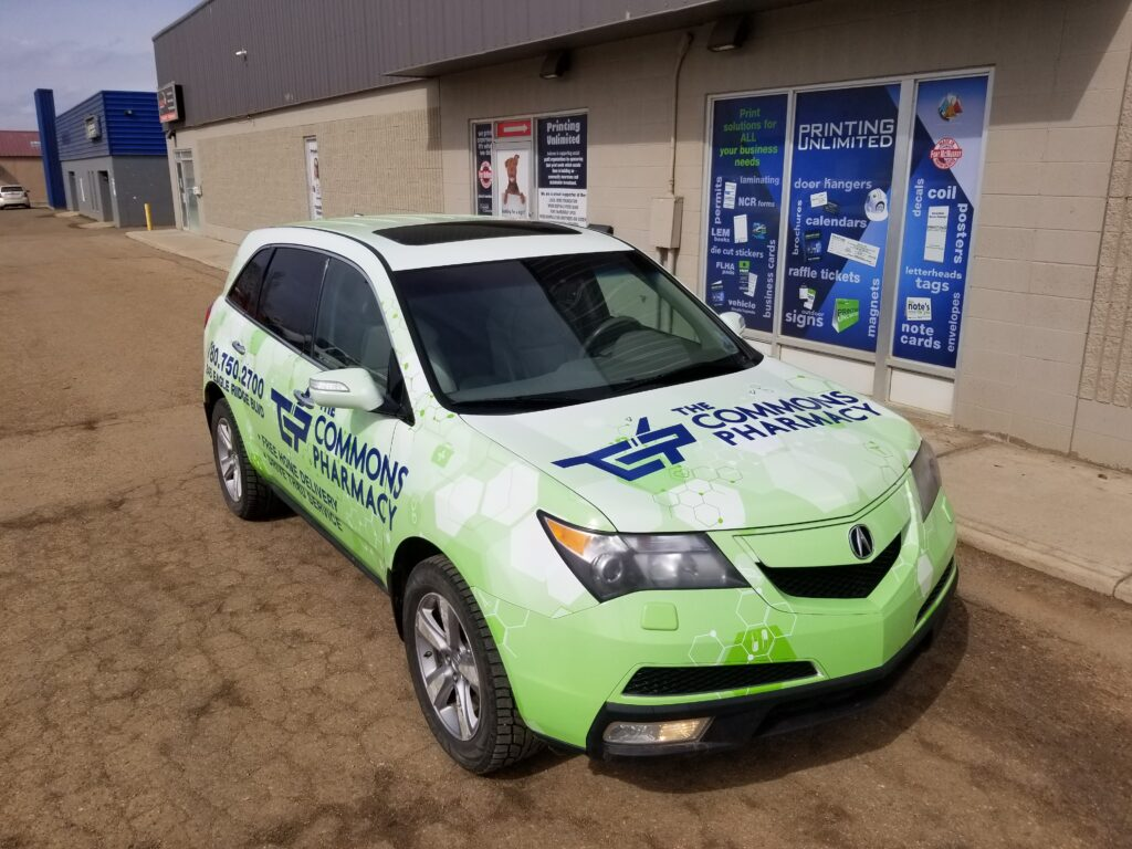 The car is covered in print. It has the business logo, and the three primary colours are green, white and blue.